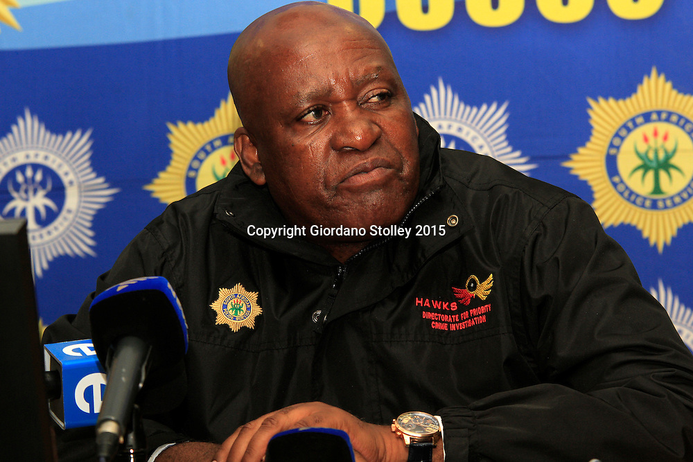 DURBAN, 16 December 2015 - Major General Berning Ntlemeza, the head of the South African  police's elite Directorate for Priority Crime Investigations answers questions at a press cnference where he had earlier told reporters that he has submitted a proposal that anyone convicted of being illegally in possession of a gun should be subjected to a minimum term of life imprisonment, which in South Africa is 25 years, before parole consideration. Ntlemeza was speaking at a press conference to launch the police's annual festive season crackdown. South Africa has one of the highest murder rates in the world, with  17,805 murders committed from April 2014 to March 2015 or an average of 49 murders everyday. Picture: Allied Picture Press/APP
