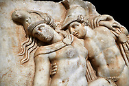 Detail of a Roman Sebasteion relief sculpture of Achilles and a dying Amazon, Aphrodisias Museum, Aphrodisias, Turkey.     Against a black background.<br /> <br /> Achilles supports the dying Amazon queen Penthesilea whom he has mortally wounded. Her double headed axe slips from her hands. The queen had come to fight against the Greeks in the Trojan war and Achilles fell in love with her. .<br /> <br /> If you prefer to buy from our ALAMY STOCK LIBRARY page at https://www.alamy.com/portfolio/paul-williams-funkystock/greco-roman-sculptures.html . Type -    Aphrodisias     - into LOWER SEARCH WITHIN GALLERY box - Refine search by adding a subject, place, background colour, museum etc.<br /> <br /> Visit our ROMAN WORLD PHOTO COLLECTIONS for more photos to download or buy as wall art prints https://funkystock.photoshelter.com/gallery-collection/The-Romans-Art-Artefacts-Antiquities-Historic-Sites-Pictures-Images/C0000r2uLJJo9_s0