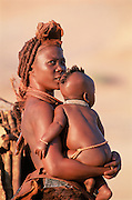Himba woman & child, traditional dress. Kaokoland Namibia