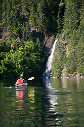 Waterfall and Kayaker, Ross Lake National Recreation Area, North Cascades National Park, Washington, US