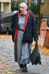 © Licensed to London News Pictures. 21/11/2012. westminster, UK A nun arrives at Church House in Westminster, London for day three of the three-day Church of England General Synod. Members last night voted against ordaining women as priests.. Photo credit : Stephen Simpson/LNP