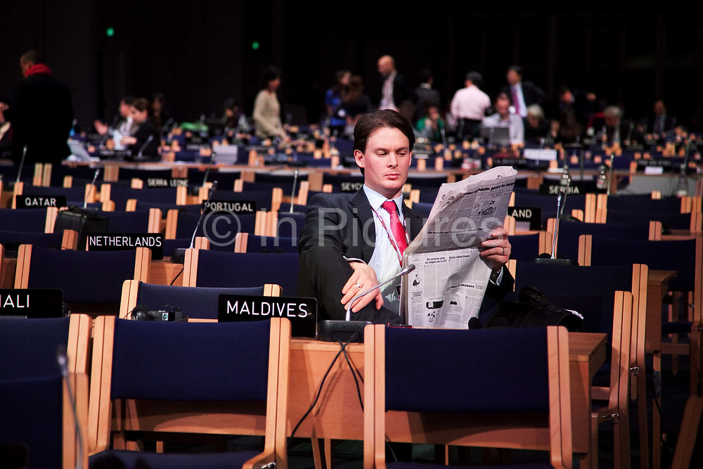 Patrick, helping representing the Maldives, taking a breather. All hope for a fair, ambitious and legally binding climate treaty demanded by most developing countries and NGOs including Greenpeace has now gone.