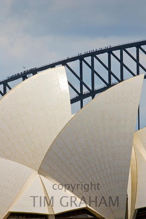 Sydney Opera House and tourists walking over  the Sydney Harbour Bridge walkway, Australia
