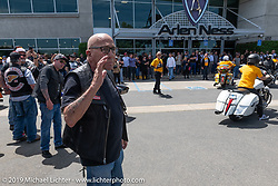 Hells Angels' founding member Sonny Barger helps direct bikes into the shop parking lot for the Arlen Ness Memorial - Celebration of Life ride from the CrossWinds Church in Livermore to the Arlen Ness Motorcycle store in Dublin, CA, USA. Saturday, April 27, 2019. Photography ©2019 Michael Lichter.