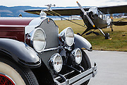 The front end of a 1929 Packard Model 640 Super 8 Phaeton and an L4 Grasshopper at WAAAM.