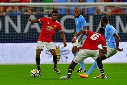 Manchester United defender Eric Bailly (3) moves the ball out of the back field during play a the International Champions Cup match between Manchester United and Manchester City at NRG Stadium in Houston, Texas