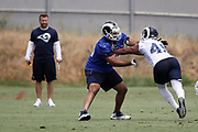 Los Angeles Rams rookie offensive tackle Joe Noteboom (70), a 3rd round pick in the 2018 NFL draft, blocks Los Angeles Rams rookie defensive end Trevon Young (49), a 6th round pick in the 2018 NFL draft, during the Los Angeles Rams NFL football camp on Monday, June 4, 2018 in Thousand Oaks, Calif. (©Paul Anthony Spinelli)