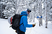 Diamond Peaks Ski Patrol director Owen Richard performs an avalanche transceiver check at the beginning of a duty day in the Montgomery Pass area, Feb. 6, 2021.