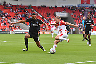 Doncaster Rovers forward Alfie May (19) crosses ball against Portsmouth FC defender Anton Walkes (2) during the EFL Sky Bet League 1 match between Doncaster Rovers and Portsmouth at the Keepmoat Stadium, Doncaster, England on 25 August 2018.Photo by Ian Lyall.