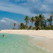 People swimming near Koh Lipe beautiful white sand beach, Thailand