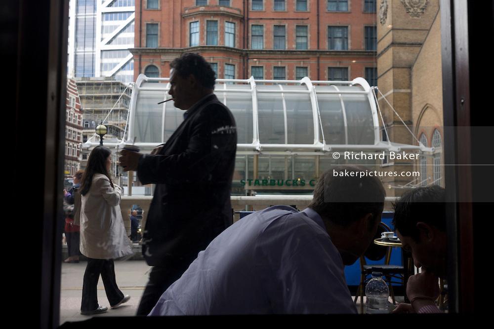 City men seen through a City of London cafe.