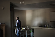 """HUNTSVILLE, AL – NOVEMBER 24, 2014: <br /> William Zonicle on lunch break in his single bedroom apartment. Zonicle, 23, graduated from Oakwood University in May 2014 with a bachelor's degree in healthcare administration, but good grades and a successful internship were not enough to help him land him a job in his field upon graduation. The recent unemployment rate among college graduates between 22 and 27 years old is rising much higher for African Americans than for their caucasian peers. In 2013, the jobless rate among blacks was 12.4 percent, compared to 4.9 percent among whites. """"It's been difficult,"""" Zonicle said, who has applied for at least 25 job openings in his field of healthcare finance or operations. """"I want to contribute to a thriving health system."""" In the meantime, Zonicle spends his days managing a university bookstore, making $7.60 an hour.  CREDIT: Bob Miller for The New York Times"""