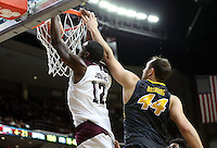 Texas A&M's Jalen Jones (12) dunks over Missouri's Ryan Rosburg (44) during the second half of an NCAA college basketball game, Saturday, Jan. 23, 2016, in College Station, Texas.  Texas A&M won 66-53.  (AP Photo/Sam Craft)