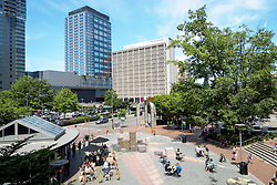 United States, Washington, Bellevue. People in plaza in downtown Bellevue.