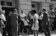 Vivian Malone entering Foster Auditorium to register for classes at the University of Alabama.  One of the first African Americans to attend the university. Photographer:  Warren K.Leffler.