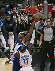 October 19, 2018 - Los Angeles, California, U.S - Tobias Harris #34 of the Los Angeles Clippers tries to block Dennis Schroder #17 of the Oklahoma Thunder during their NBA game on Friday October 19, 2018 at the Staples Center in Los Angeles, California. Clippers defeat Thunder, 108-92. (Credit Image: © Prensa Internacional via ZUMA Wire)