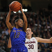 Brittany Hrynko, DePaul, rebounds during the UConn Vs DePaul, NCAA Women's College basketball game at Webster Bank Arena, Bridgeport, Connecticut, USA. 19th December 2014