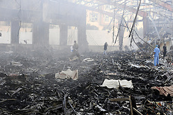 SANAA, Oct. 8, 2016 (Xinhua) -- People search for victims inside a funeral hall after it was targeted by airstrikes in Sanaa, Yemen, on Oct. 8, 2016. The Saudi-led coalition airstrikes on a funeral hall in Yemen's capital Sanaa on Saturday have killed 82 and injured 534, acting health minister Ghazi Ismail told reporters in a press conference on Saturday night. (Xinhua/Mohammed Mohammed) (Credit Image: © Mohammed Mohammed/Xinhua via ZUMA Wire)