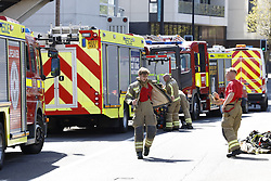 © Licensed to London News Pictures. 07/05/2021. London, UK. Fire fighters are still on scene at New Providence Wharf on Fairmont Avenue in Poplar in east London. 100 fire fighters and 20 crews tackled the blaze at it's peak. Photo credit: Peter Macdiarmid/LNP