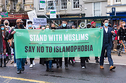 © Licensed to London News Pictures; 06/12/2020; Bristol, UK. Anti-Islamophobia Bristol: MARCHING FOR MUSLIMS march and rally in the city centre. The march is to protest the injustice of the recent coroner's ruling that Shurki Abdi's drowning in the River Irwell near Manchester in 2019 was an accident, despite what the campaign says is evidence to show otherwise, and to demand justice for her and her family, and over the French Government reaction to the attempted murder or two muslim women at the Eiffel Tower. The Anti-Islamophobia campaign has the following demands: UK government must condemn the tone and direction taken by the French government; UK government must demand harsher charges for race and faith based attempted murder by the attackers; Government must stand against the conflation of terrorism and Muslims; Government to produce a public statement standing for the rights of Muslims to practice openly and freely; UK government to commit to a formal review on the extent of Islamophobia within its own structures. The organiser says this is to send the message to Muslims and our allies, that Islamophobia is an emergency exception and requires action and solidarity even in a pandemic. The event was postponed from November due to the England lockdown for the Covid-19 coronavirus pandemic and attendees are asked to bring PPE and to have no groups more than 6 people. Photo credit: Simon Chapman/LNP.