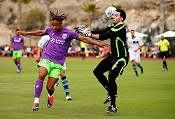 Bobby Reid of Bristol City challenges the goalkeeper - Mandatory by-line: Matt McNulty/JMP - 22/07/2017 - FOOTBALL - Tenerife Top Training - Costa Adeje, Tenerife - Bristol City v Atletico Union Guimar  - Pre-Season Friendly