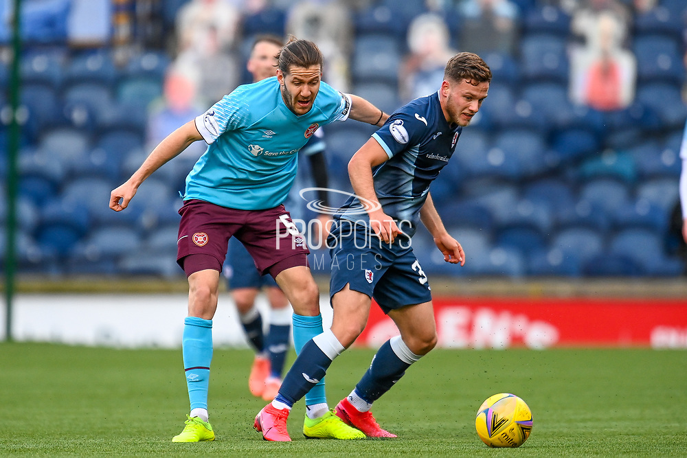 Jamie Gullan (32) of Raith Rovers FC shields the ball from Peter Haring (#5) of Heart of Midlothian FC during the SPFL Championship match between Raith Rovers and Heart of Midlothian at Stark's Park, Kirkcaldy, Scotland on 30 April 2021.