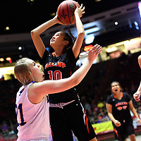 Bloomfield Bobcat Halle Payne (10), left, guards Gallup Bengal Cearra Williams (10) during a District 5A semifinal at The Pit in Albuquerque Thursday.  The Bengals fell to the Bobcats 59-56.