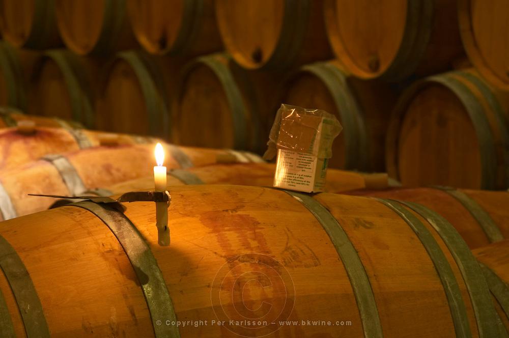 The winery, barrel aging cellar: a burning candle, a box of sulphur pellets - Chateau Baron Pichon Longueville, Pauillac, Medoc, Bordeaux, Grand Cru