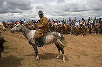 """Spectators line up to watch the horse racing during Nadaam, Mongolia's National Holiday,North East Mongolia.<br /> Available as Fine Art Print in the following sizes:<br /> 08""""x12""""US$   100.00<br /> 10""""x15""""US$ 150.00<br /> 12""""x18""""US$ 200.00<br /> 16""""x24""""US$ 300.00<br /> 20""""x30""""US$ 500.00"""