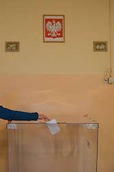 November 4, 2018 - Krakow, Poland - A local lady casts her vote in the second round of  local elections 2018, in Krakow Polling Station number 10...On Sunday, November 4, 2018, in Krakow, Poland. (Credit Image: © Artur Widak/NurPhoto via ZUMA Press)