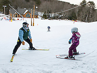 Ski Instructor Becky Bartlett works with Bree on her turns during Thursday night lessons at the Abenaki Ski Area in Wolfeboro.  (Karen Bobotas/for the Laconia Daily Sun)