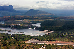 Aerial view of Canaima Lagoon waterfalls at river Carrao in Venezuela. Tepuis (table mountains) in the background