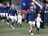 Picture by Andrew Tobin/Focus Images Ltd +44 7710 761829.26/05/2013.Rob Webber leads England onto the pitch with mascot during the match between England and the Barbarians at Twickenham Stadium, Twickenham.