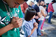 Mar. 30, 2009 -- PHOENIX, AZ: JESUS ZAZUETA, 14, prays during a prayer vigil and fast against Maricopa County Sheriff Joe Arpaio. About 15 people in Phoenix are fasting and praying, hoping that Maricopa County Sheriff Joe Arpaio will resign. Because of the anti-immigrant raids his deputies have conducted Arpaio has become a lightning rod in the immigration debate. Arpiao's supporters contend that the Sheriff is simply enforcing the law, his opponents, including Phoenix Mayor Phil Gordon, contend that the sheriff is using racial profiling and other illegal means to make arrests and stop people.  Photo by Jack Kurtz