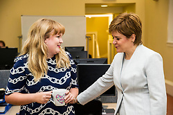Pictured: First Minister Nicola Sturgeon met neighbour Rosie Brotherwood<br /> <br /> Ahead of the Programme for Government, First Minister Nicola Sturgeon visited  IT company  Digital Net in Edinburgh.  DIgital Net use innovative digital training to upskill their young workforce. During the visit, Ms Sturgeon met modern apprentices taking part in a digital skills lesson in their dedicated digital skills classroom.<br /> <br /> Ger Harley: 5 September 2017