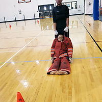 Isaiah Garcia demonstrates the rescue drag portion of the CPAT part of the SkillsUSA firefighting contest. Garcia is a recent Central High School graduate and was concurrently enrolled in the fire science program.