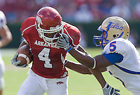 FAYETTEVILLE, AR - NOVEMBER 1:   Jarius Wright #4 of the Arkansas Razorbacks is tackled by the face mask by DeAundre Brown #5 of the Tulsa Golden Hurricanes at Donald W. Reynolds Stadium on November 1, 2008 in Fayetteville, Arkansas.  The Razorbacks defeated the Golden Hurricanes 30 to 23.  (Photo by Wesley Hitt/Getty Images) *** Local Caption *** Jarius Wright; DeAundre BrownUniversity of Arkansas Razorback Men's and Women's athletes action photos during the 2008-2009 season in Fayetteville, Arkansas....©Wesley Hitt.All Rights Reserved.501-258-0920.