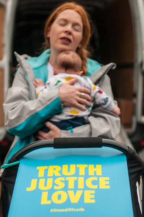 """Dublin, Ireland. 26th August, 2018. <br /> A young irish mum embraces her child during the the Stand4Truth protest during the second of the two-days of the visit of Pope Francis in Dublin, Ireland.<br /> Pope Francis has made a two-day visit to the Republic of Ireland by celebrating a Mass at Dublin's Phoenix Park. The Argentine Pope asked forgiveness for the """"abuses in Ireland, abuses of power, conscience and sexual abuses"""" perpetrated by Church leaders. It was the first papal visit to Ireland for 39 years. During his activities many activists, victims and survivors have made protests and a silent march Garden of Remembrance towards the last Magdalene Laundry to close in Ireland.<br />  © Simone Padovani"""