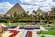 Pyramids and colored flower arrangements at the Mena House Hotel in Giza near Cairo, Egypt
