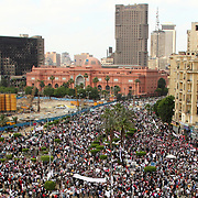 View of Tahrir Square rally leading up to the Egyptian Museum, with the burned out National Council for Women behind.