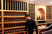 A man walks past a shelf of wines produced from Winston Wine's own Australian winery at one of its stores in Shanghai, China on 18 October, 2011. Photographer: Qilai Shen/BloombergA staff member walks past a rack of wine at Australia's Winston Wines Pty's store in Shanghai, China, on Tuesday, Oct. 18, 2011. Australian vineyards, facing slumping exports and rising competition, are turning to China as Chinese buyers creating surging demand among the nation's rich, who are developing a taste for wine and the expression of wealth and class it conveys.