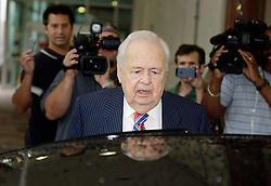 12 June  2015. New Orleans, Louisiana. <br /> Tom Benson, billionaire owner of the NFL New Orleans Saints, the NBA New Orleans Pelicans, various auto dealerships, banks, property assets and a slew of business interests leaves the New Orleans Civil District Court with his attorney Phillip Whitman where they are attending a hearing to determine Benson's level of competency to manage his business empire. Benson changed his succession plans and  decided to leave the bulk of his estate to third wife Gayle, sparking a controversial fight over control of the Benson business empire.<br /> Photo©; Charlie Varley/varleypix.com