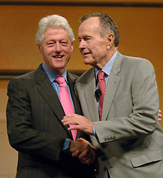 Former president Bill Clinton (left) jokes with former President George H.W. Bush during their joint appearance at the CTIA Wireless 2007 convention at the Orange County Convention Center in Orlando, Florida, Thursday, March 29, 2007. Both presidents delivered individual speeches to the convention delegates, and then appeared together for a question-and-answer session. Photo by Joe Burbank/Orlando Sentinel/MCT/ABACAPRESS.COM