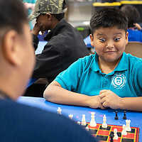 Talon Andy, 9, reacts to a move by his opponent in a chess match Wednesday, May 22 during Chess Club at the Octavia Fellin Public Library Children's Branch.