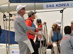 Kim Moon Soo, Governor of Gyeonggi Province joins Peter Gilmour, Yanmar Racing at the helm for the Pro-Am race. Photo:Chris Davies/WMRT