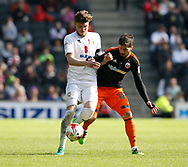 Robbie Muirhead of MK Dons in action with Kieron Freeman of Sheffield Utd during the English League One match at  Stadium MK, Milton Keynes. Picture date: April 22nd 2017. Pic credit should read: Simon Bellis/Sportimage