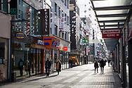 Corona Lockdown, December 17th. 2020. Only few people on shopping street Hohe Strasse, usually visited by thousands of people, Cologne, Germany.<br /> <br /> Corona Lockdown, 17. Dezember 2020. Nur sehr wenige Menschen in der Fussgaengerzone Hohe Strasse, normalerweise von tausenden Menschen besucht,  Koeln, Deutschland.