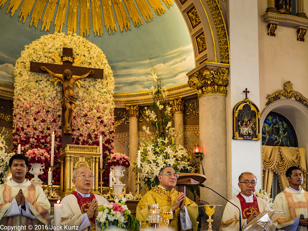 18 SEPTEMBER 2016 - BANGKOK, THAILAND:  FRANCIS XAVIER KRIENGSAK, the Archbishop of Bangkok, (CENTER) leads100th anniversary mass at Santa Cruz Church. Santa Cruz Church was establised in 1769 to serve Portuguese soldiers in the employ of King Taksin, who reestablished the Siamese (Thai) empire after the Burmese sacked the ancient Siamese capital of Ayutthaya. The church was one of the first Catholic churches in Bangkok and is one of the most historic Catholic churches in Thailand. The first sanctuary was a simple wood and thatch structure and burned down in the 1800s. The church is in its third sanctuary and was designed in a Renaissance / Neo-Classical style. It was consecrated in September, 1916. The church, located on the Chao Phraya River, serves as a landmark for central Bangkok.      PHOTO BY JACK KURTZ