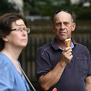 People eating ice-cream at the Green Park as Heatwaves continues in the UK on July 22 2018,  London, UK