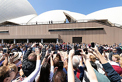 AU_1369901 - Sydney, AUSTRALIA  -  Prince Harry and Meghan tour Opera House, Taronga Zoo after baby news. Royal watchers swamp Opera House for Meghan Markle and Prince Harry's first day on tour downunder.<br /> <br /> BACKGRID Australia 16 OCTOBER 2018 <br /> <br /> BYLINE MUST READ: Trevor Goddard / BACKGRID<br /> <br /> Phone: + 61 2 8719 0598<br /> Email:  photos@backgrid.com.au